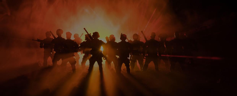 Men in Glow of Flares